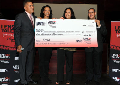 "BET's Paxton Baker, Tracey Costello, Phyllis Toben Bancroft and Johnson & Johnson's Anthony Carter hold the grand prize check presented for the movie ""RENT"" at the ""Lens On Talent"" grand prize winner reception."